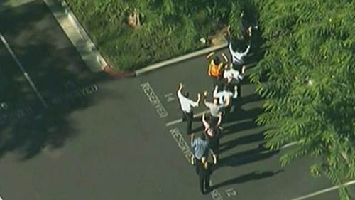 People were seen fleeing the building with their arms raised. (ABC NEWS)
