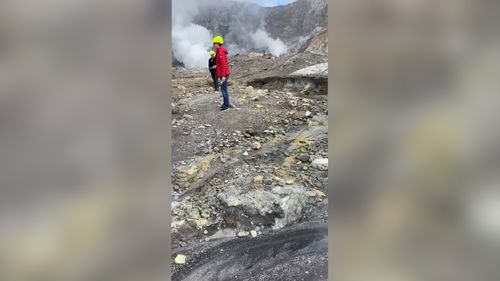 Tourists were videoed exploring the crater while gas poured from the ground.