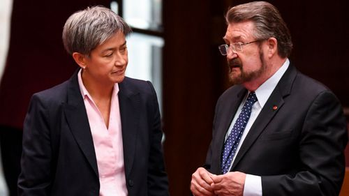 The leader of the Opposition in the Senate Senator Penny Wong, left, speaks to Senator Derryn Hinch after the passing of the Medivac bill.