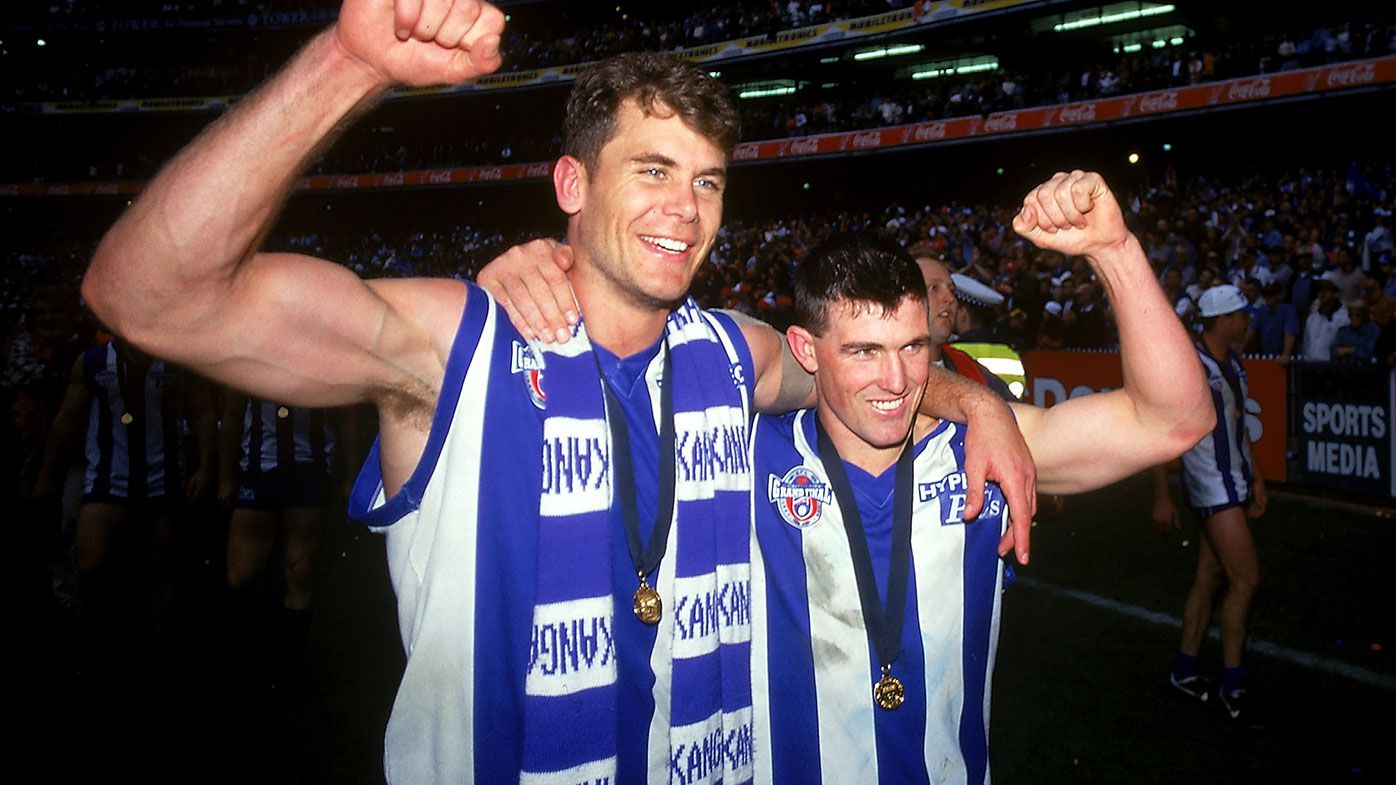 1996: (L-R) Wayne Carey and Anthony Stevens of the Kangaroos celebrate victory after the AFL Grand Final match between the North Melbourne Kangaroos and the Sydney Swans at the Melbourne Cricket Ground 1996, in Melbourne, Australia. (Photo by Getty Images)