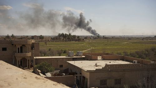 Columns of black smoke billow from the last small piece of territory held by Islamic State militants as US-backed fighters pounded the area with artillery fire and occasional airstrikes in Baghouz, Syria.