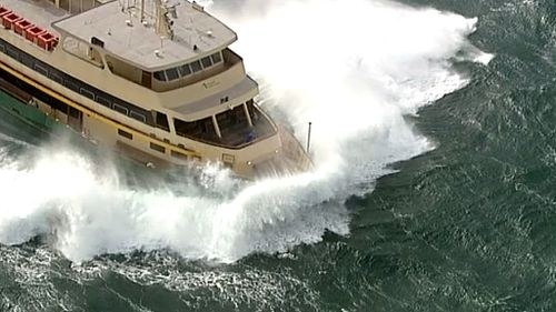 Wild winds in Sydney made the harbour choppy for the ferry. (9NEWS)