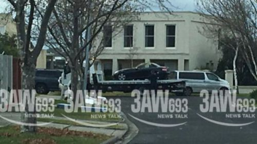 The black Mercedes was towed from outside Ms Ristevski's Avondale Heights home this afternoon. (3AW Melbourne)