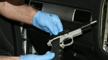 Gun, ammunition and cash seized in bikie raid