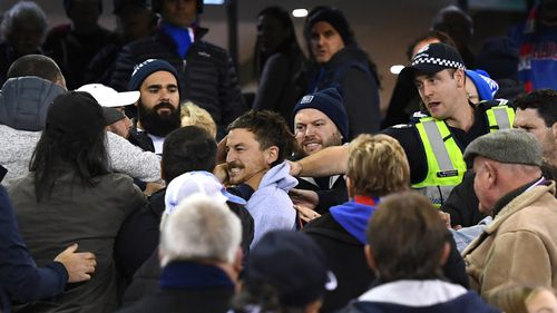 Fans brawl after the final siren of the Carlton-Western Bulldogs thriller.