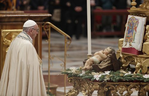 Pope Francis kisses a statue of the Divine Infant as he celebrates a new year's eve vespers Mass in St. Peter's Basilica at the Vatican, Sunday, Dec. 31, 2017.  (AAP)