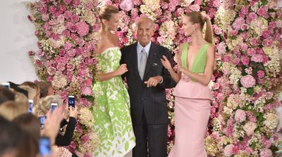 Oscar de la Renta with models Karlie Kloss and Daria Strokous at his Spring 2015 show in New York in September. (Getty)