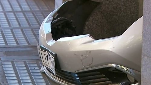 The impact of the crash left the silver vehicle with significant damage to the front bumper.