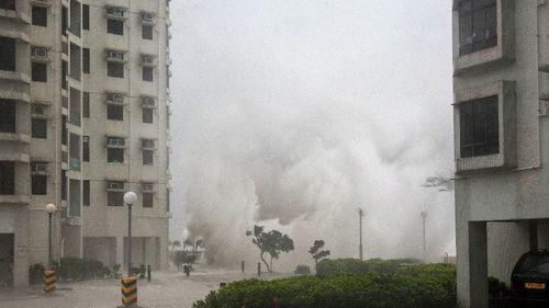 Waves crash ashore as a powerful typhoon hits Hong Kong.