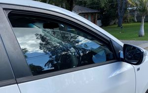 Family fined for leaving car window open while parked at home