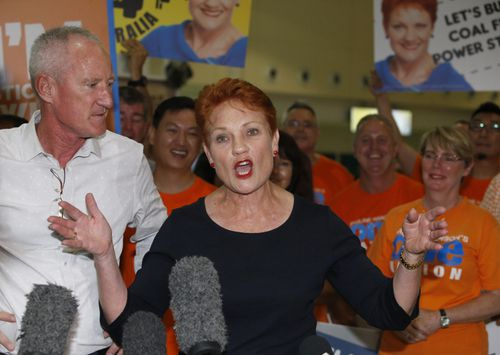 One Nation leader and senator Pauline Hanson flanked by state leader Steve Dickson at Brisbane Airport last night. (AAP)