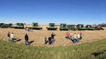 Community in Lennox, South Dakota help a grieving family by harvesting the farmers corn. (Bruce DeNui)