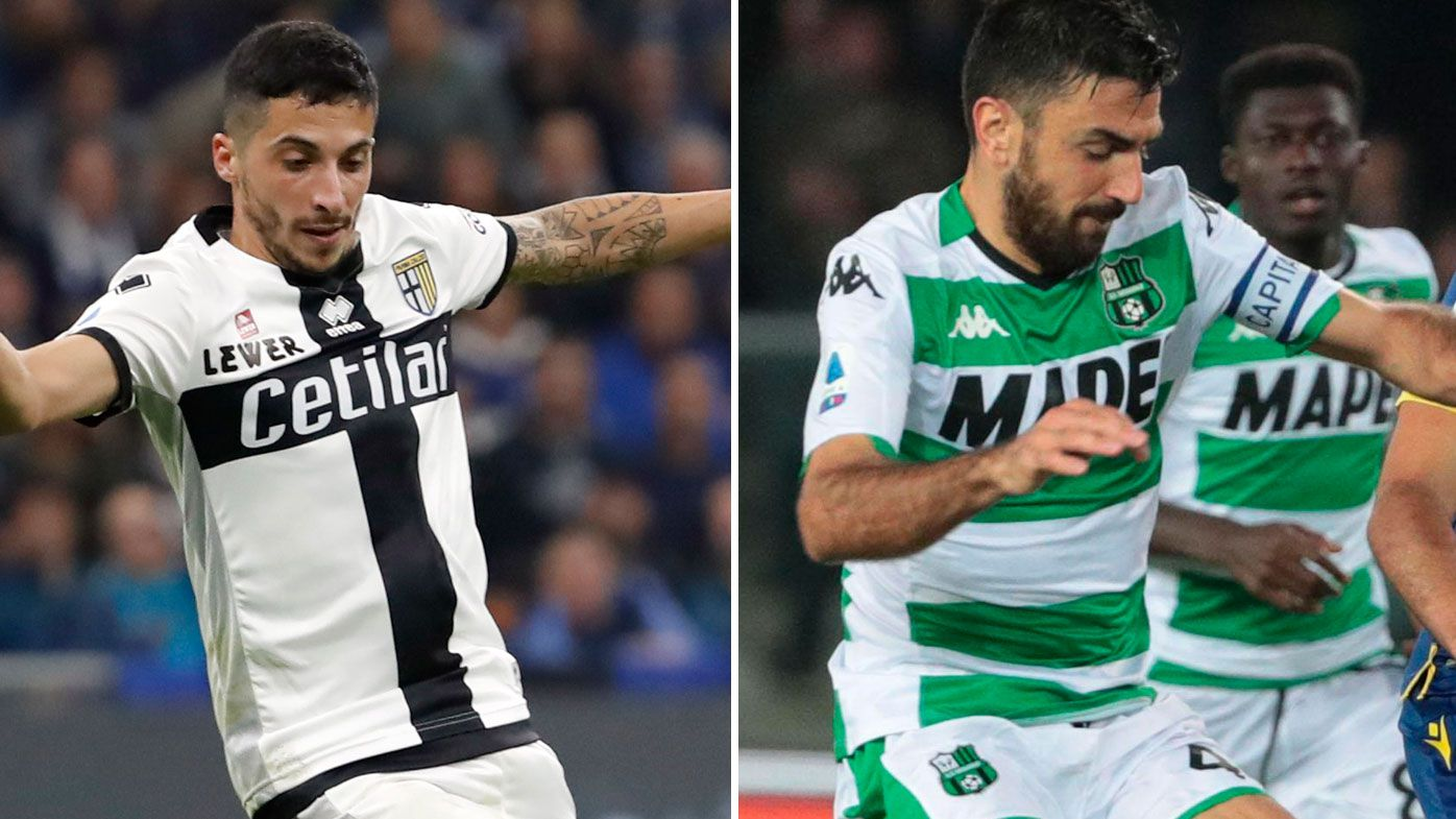 Parma's Matteo Scozzarella, left, Sassuolo's Francesco Magnanelli, right.