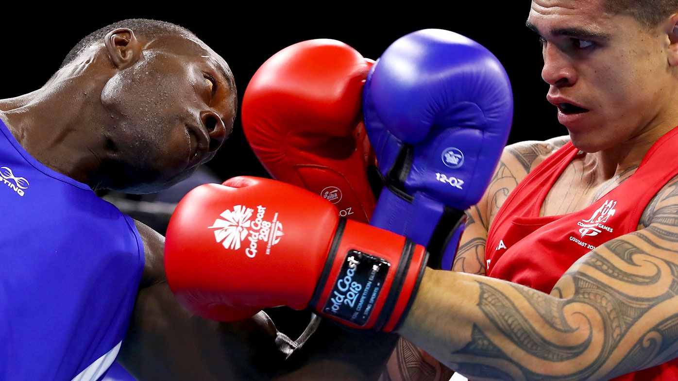 Mbachi Kaonga of Zambia and Clay Waterman of Australia compete during the Men's 81kg Quarterfinal bout of the boxing. (Getty)