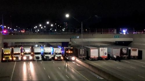 Michigan Police teamed up with 13 semi-trailer truckers to prevent a man from taking his own life on Detroit's I-696 highway. Picture: Fox2 News.