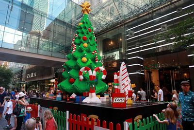 In Sydney's Pitt Street Mall, a Christmas tree made of Lego attracts a constant admiring crowd. (Lisa Maree Williams/Getty)