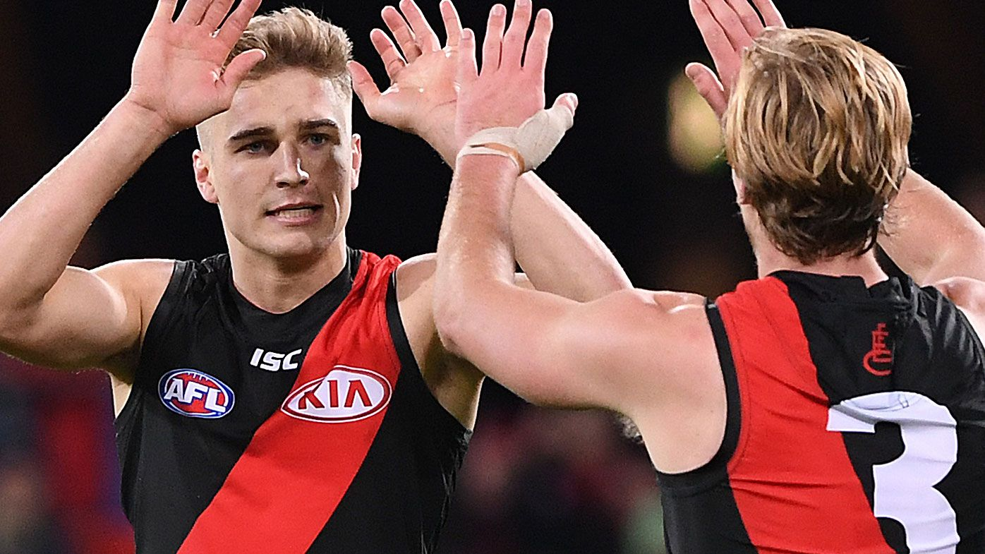 Bombers run away from tiring Suns in AFL