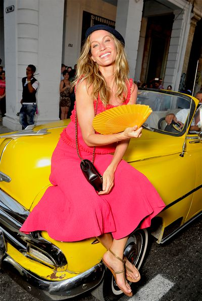 """<p>""""The colours, the cars, there's something very touching about it. Cuba is like nothing else in the world,"""" Karl Lagerfeld told WWD concerning yesterday's <a href=""""http://honey.ninemsn.com.au/2016/05/05/08/12/chanel-cruise-201617-collection"""" target=""""_blank"""">Chanel Cruise 2016/17 show</a>. """"It has an identity I love, and I always wanted to go, but I need a professional reason.""""</p><p>True to Karl's vision, guests of the star-studded show were treated the full Cuban experience. Ferried to Havana's historic Paseoel Prado in candy-paint convertibles from the '40s and '50s, VIPs took their places on park benches as Latin beats played. Chanel muse Gisele Bündchen wore a beret and fanned herself with a bright yellow fan, while Tilda Swinton rocked a guayabera like no other.</p>Click through to see all the attendees."""