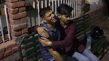 A father grieves the death of his son after the school bus plunged off a mountain road in India.