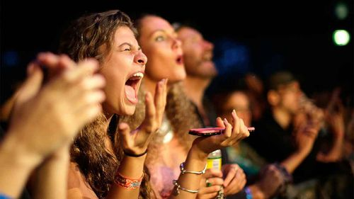 Fans react to The Wailers performing live on stage at the 2016 Byron Bay Bluesfest.