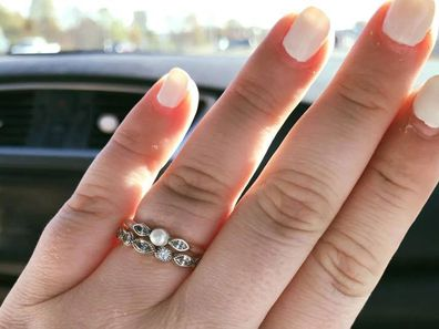 """A clerk came over to them and commented how """"pathetic"""" it was that some men purchase their jewellery as engagement rings."""