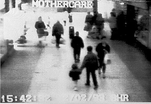 Video camera shows two-year-old James Bulger holding the hand of an unknown man. (AAP)