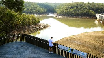 A man stands on  the viewing platform of Warragamba Dam on February 10, 2020 in Sydney, Australia.