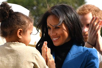 Meghan with a little girl at Kensington Palace, September 2018.