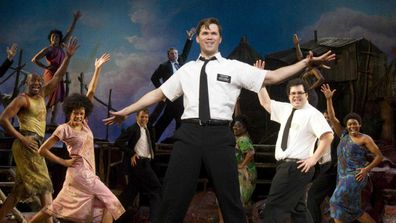 "Andrew Rannells, center, performs with an ensemble cast in ""The Book of Mormon"" at the Eugene O'Neill Theatre in New York. (AAP)"