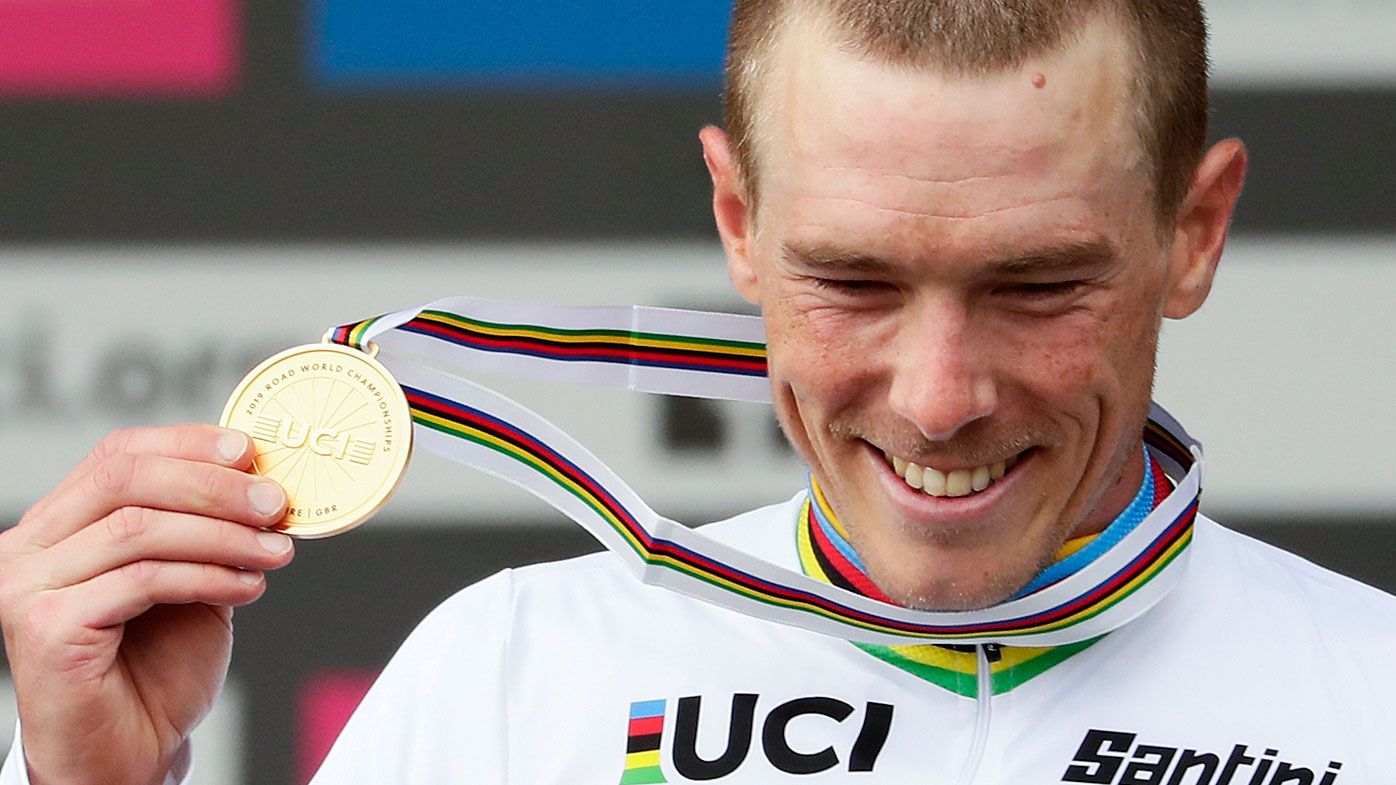 Australia's Rohan Dennis poses with his gold medal on the podium after winning the men's elite individual time trial event