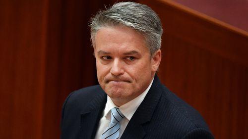 Fellow Western Australian politician Mathias Cormann said he is 'genuinely sad' to see Mr Hammond stepping down. (AAP)