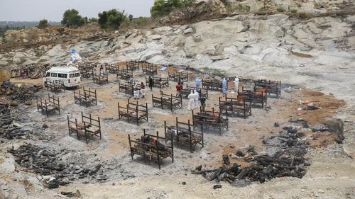 Bodies of people who died of COVID-19 are cremated at an open crematorium on the outskirts of Bengaluru, Karnataka state, India.