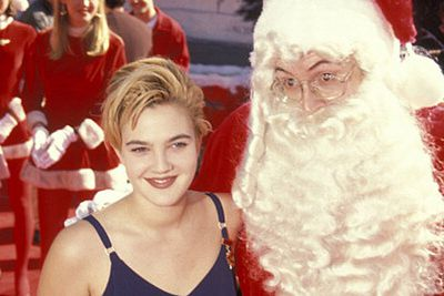 Drew Barrymore had the right demure attitude for her date with Santa.