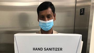 A man forced to dress as hand sanitiser.