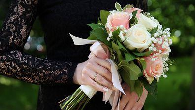 Goth wedding request bride holding flowers