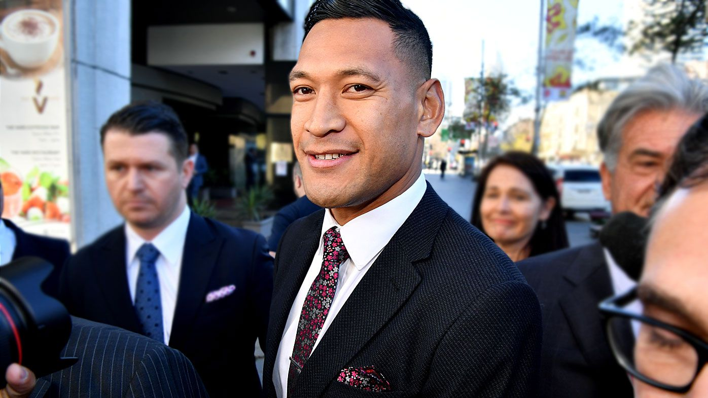 Israel Folau arrives for a conciliation hearing at the Fair Work Commission in Sydney