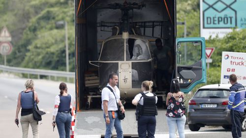 Investigators transport an Alouette II helicopter allegedly abandoned by French prisoner Redoine Faid and suspected accomplices after his escape from the prison of Reau. (AAP)
