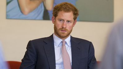 Britain's Prince Harry takes part in a round table discussion with HIV doctors at King's College Hospital in south London.