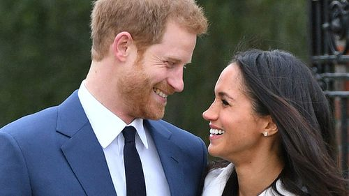 "There are four coins in the collection and feature the happy couple ""looking lovingly into each other's eyes."" (PA/AAP)"