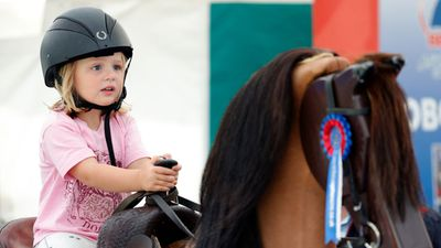 Mia Tindall rides a horse simulator, August 2017