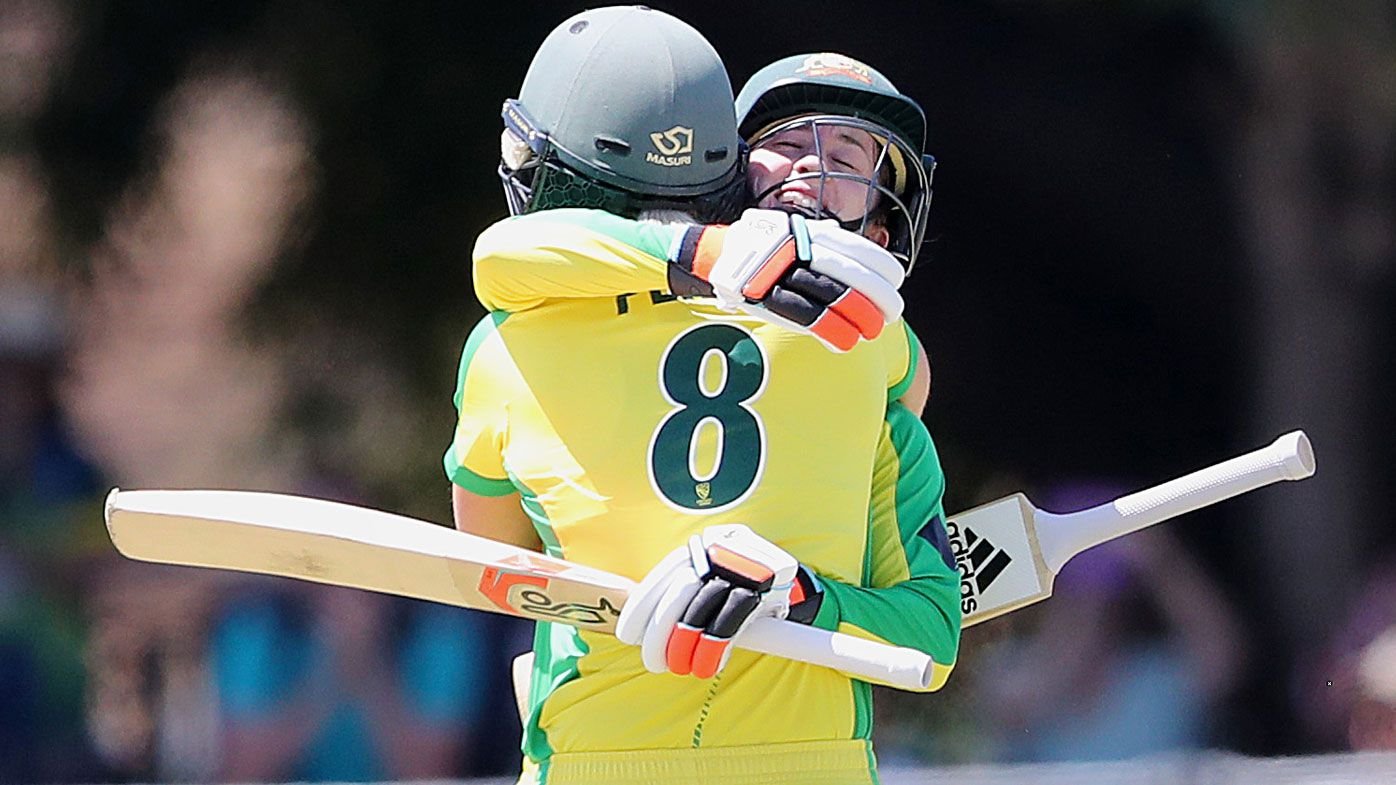 Rachael Haynes of Australia hugs team mate Ellyse Perry as she brings up 100 runs during game two of the International Women's One Day International Series between Australia and Sri Lanka