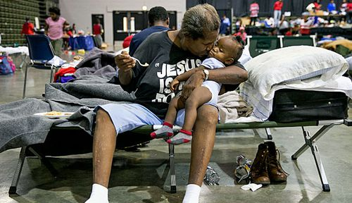 Beaumont residents at an evacuation centre in the flood-hit Texas city. (Photo: AP).