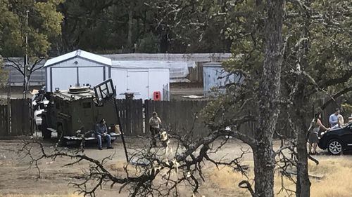 Residents and emergency personnel work at the scene of the mass shooting at Rancho Tehama in northern California. (AAP)