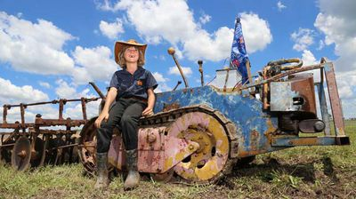 et Maguire of Clifton sits on a Ransom NE6 1940 / 50s tractor, during a Machinery show over the Australia Day weekend. (AAP)