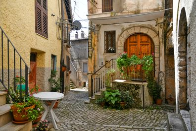 Maenza, Italy. A small street between the old stone houses of a medieval village in the province of Latina.