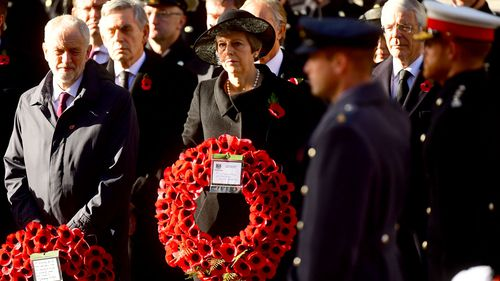 Labour leader Jeremy Corbyn and Prime Minister Theresa May watch as the Royal family lay wreaths during the remembrance service at the Cenotaph memorial in Whitehall, central London.