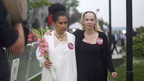 Accuser Lili Bernard walks with Caroline Heldman outside the Montgomery County Courthouse on the opening day of the sexual assault trial June 5, 2017 in Norristown, Pennsylvania.