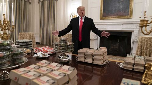 Donald Trump served fast food to college athletes because the White House kitchen staff are unable to work.