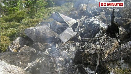 The pilot's helicopter was completely destroyed in the inferno on a Canadian hillside. (60 Minutes)