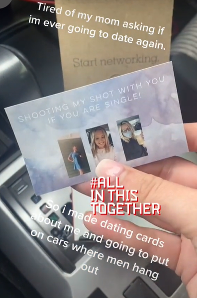 Woman hands out business cards to find love on cars